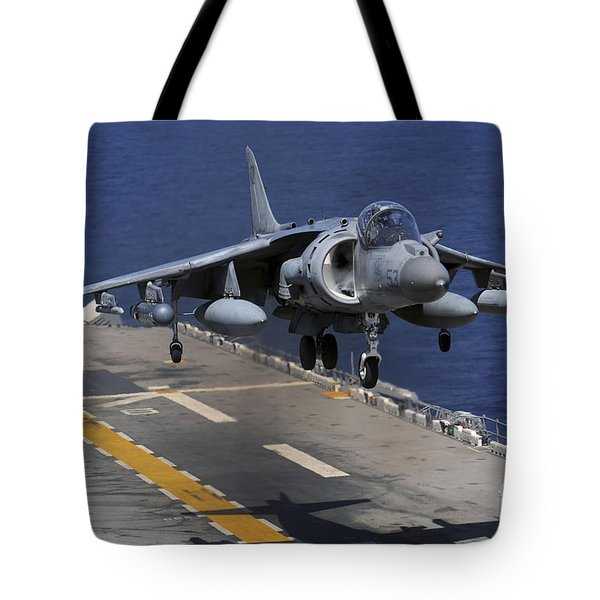 An Av-8b Harrier Jet Lands Tote Bag by Stocktrek Images
