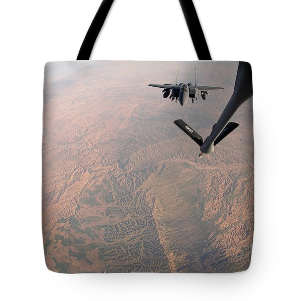 An F-15e Strike Eagle Is Refueled Tote Bag by Stocktrek Images