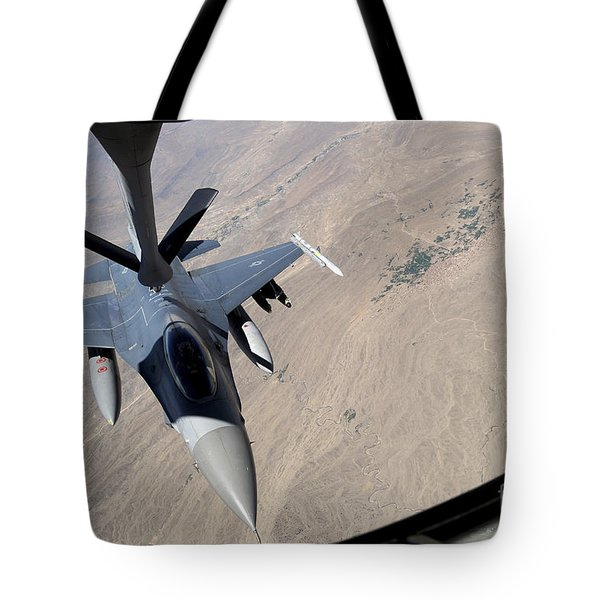 An F-16 Fighting Falcon Receives Fuel Tote Bag by Stocktrek Images