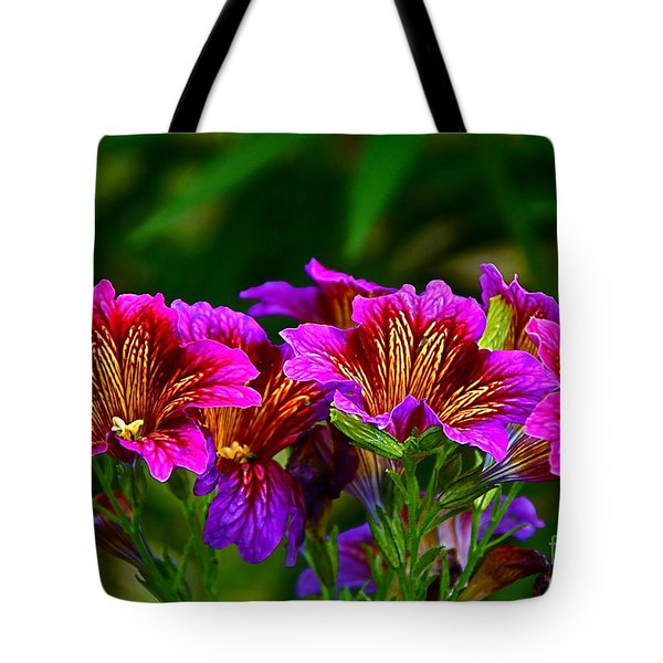 Gleaming In Purple And Gold Tote Bag by Byron Varvarigos