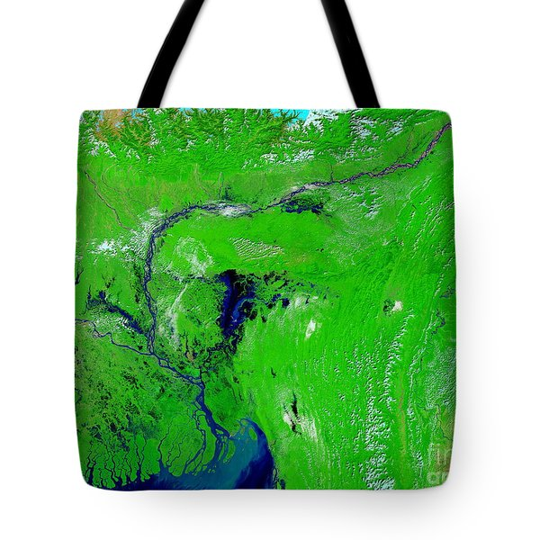 Monsoon Floods Tote Bag by NASA / Science Source