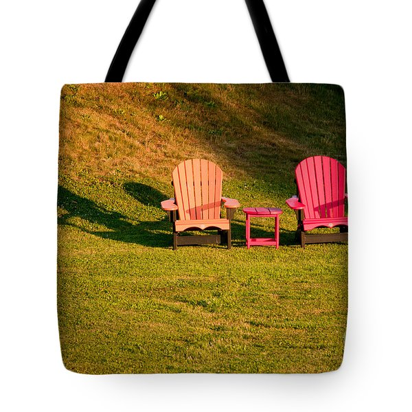 Tote Bag featuring the photograph Red And Orange Chairs by Les Palenik
