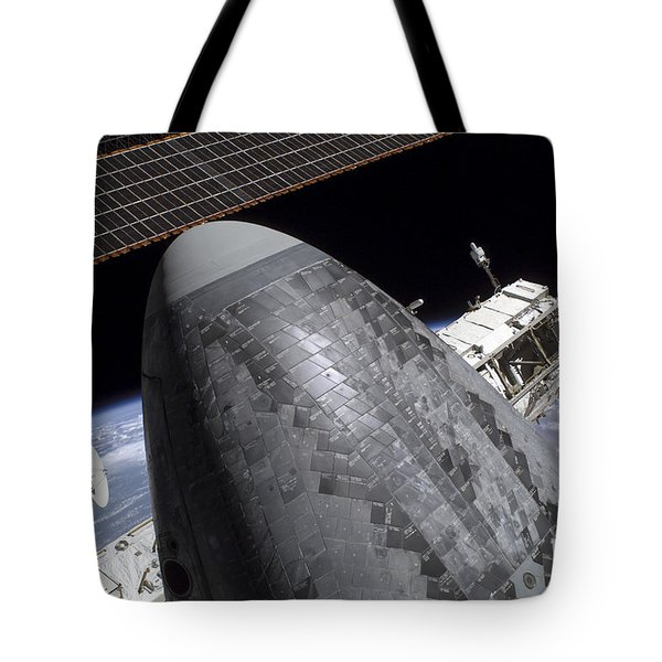 Space Shuttle Discovery Docked Tote Bag by Stocktrek Images