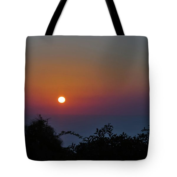 Tote Bag featuring the photograph Sunset Over The Sea by Michael Goyberg