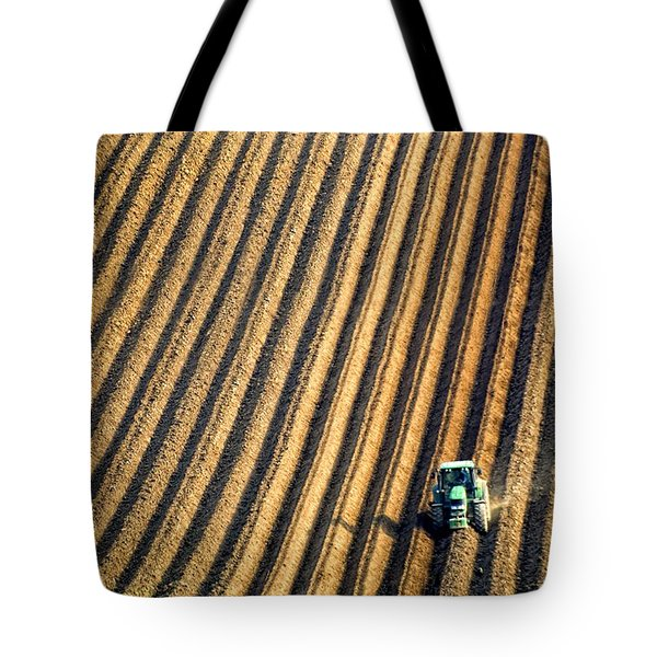 Tractor Plowing A Field Tote Bag by John Short