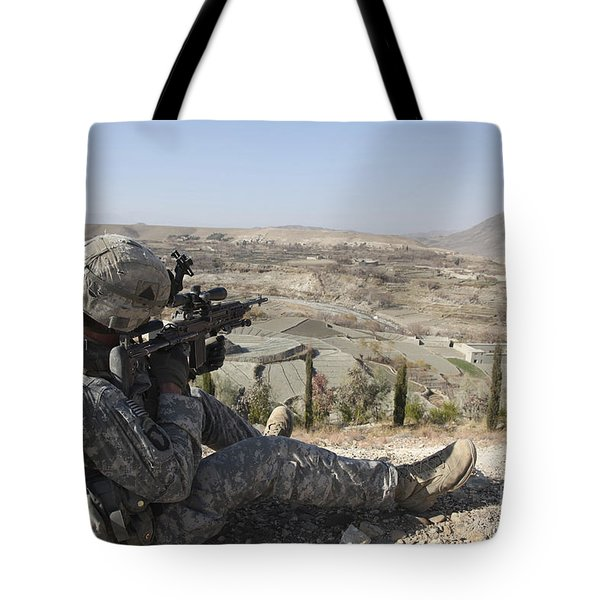 U.s Army Soldier Scans His Sector Tote Bag by Stocktrek Images