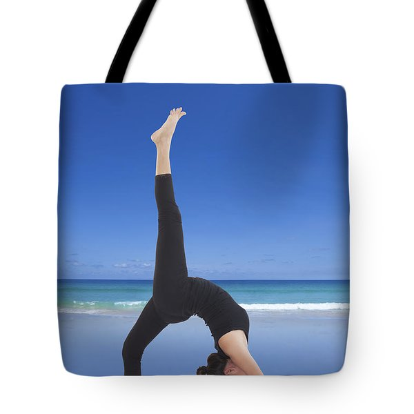 Woman Doing Yoga On The Beach Tote Bag by Setsiri Silapasuwanchai