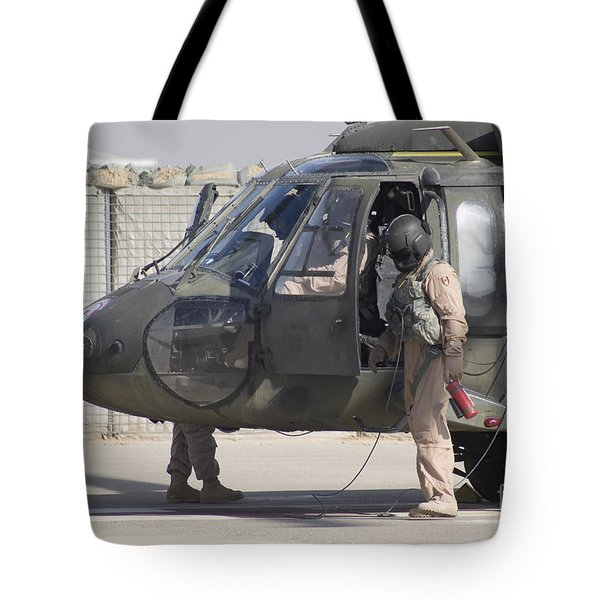 A Uh-60 Blackhawk Medivac Helicopter Tote Bag by Terry Moore