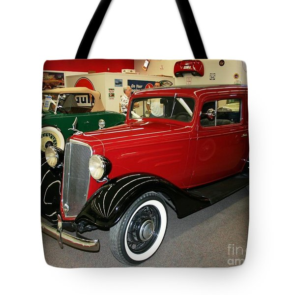 Tote Bag featuring the photograph 1930's Antique Chevrolet Sedan by John Black