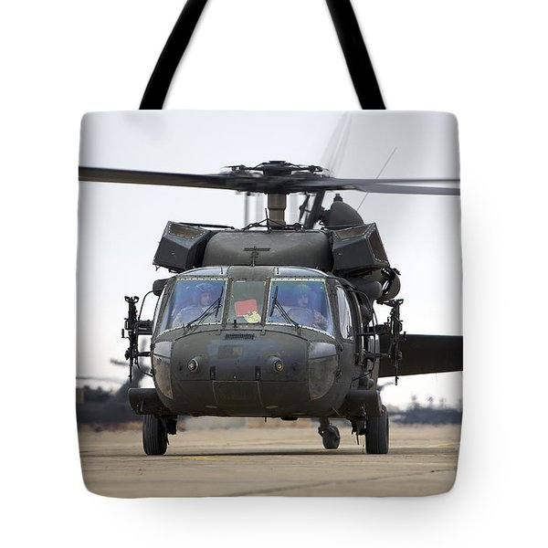 A Uh-60 Black Hawk Taxis Tote Bag by Terry Moore