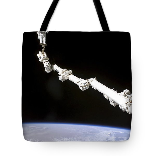 Astronaut Anchored To A Foot Restraint Tote Bag by Stocktrek Images
