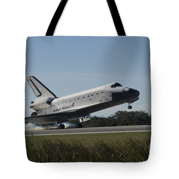 Space Shuttle Atlantis Touches Tote Bag by Stocktrek Images
