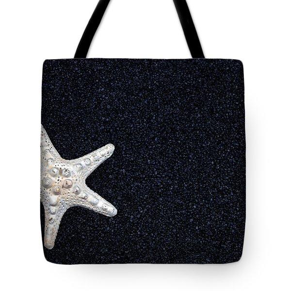 Starfish On Black Sand Tote Bag by Joana Kruse