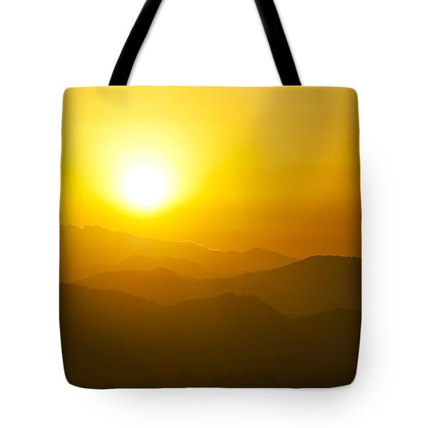 Sunset Behind Mountains Tote Bag by U Schade