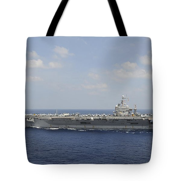 Uss Abraham Lincoln Transits The Indian Tote Bag by Stocktrek Images