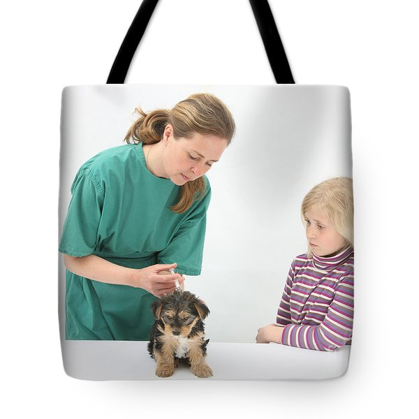 Vet Giving Pup Its Primary Vaccination Tote Bag by Mark Taylor