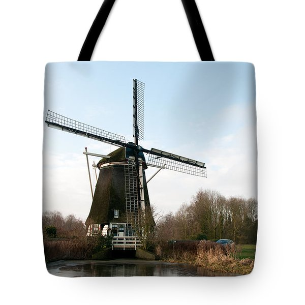 Tote Bag featuring the digital art Windmill In Amsterdam by Carol Ailles