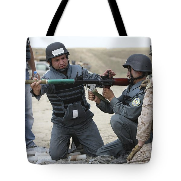 An Afghan Police Student Loads A Rpg-7 Tote Bag by Terry Moore