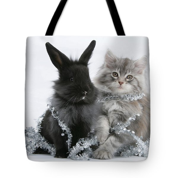 Kitten And Rabbit Getting Into Tinsel Tote Bag by Mark Taylor