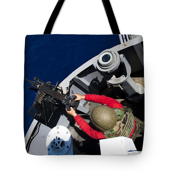 A Sailor Fires A .50-caliber Machine Tote Bag by Stocktrek Images