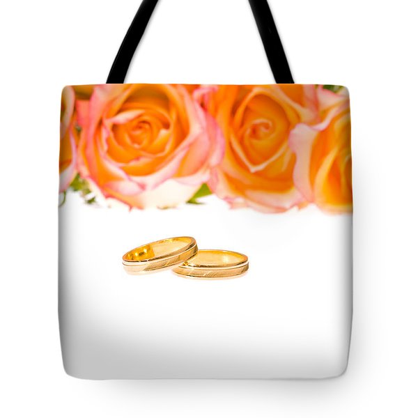4 Red Yellow Roses And Wedding Rings Over White Tote Bag by Ulrich Schade