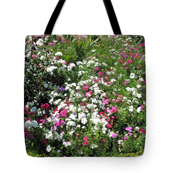 Tote Bag featuring the photograph A Bed Of Beautiful Different Color Flowers by Ashish Agarwal