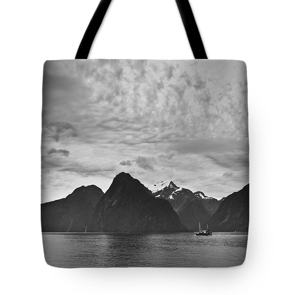 A Boat In The Water Along The Coast Tote Bag by David DuChemin