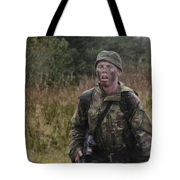 A British Soldier During Exercise Tote Bag by Andrew Chittock