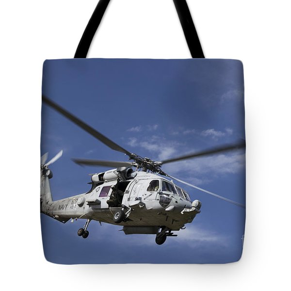 A Crew Chief Looks Out The Side Door Tote Bag