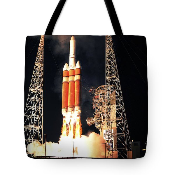 A Delta Iv Heavy Rocket Lifts Off Tote Bag by Stocktrek Images