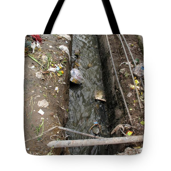 Tote Bag featuring the photograph A Dirty Drain With Filth All Around It Representing A Health Risk by Ashish Agarwal