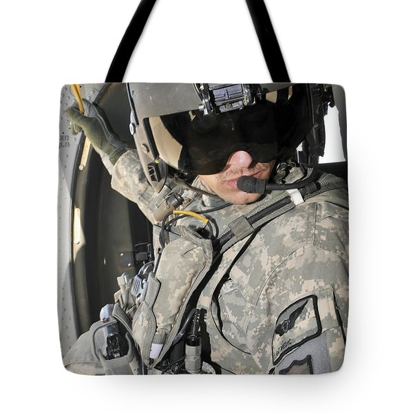 A Flight Medic Conducts A Daily Tote Bag by Stocktrek Images