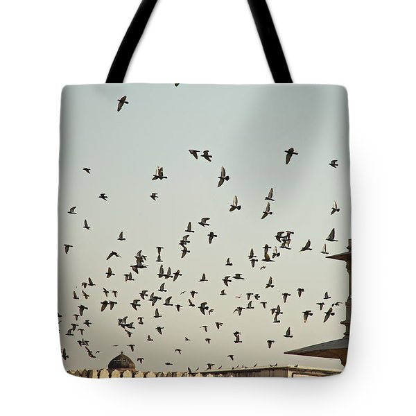 Tote Bag featuring the photograph A Flock Of Pigeons Crowding One Of The Structures On Top Of The Red Fort by Ashish Agarwal