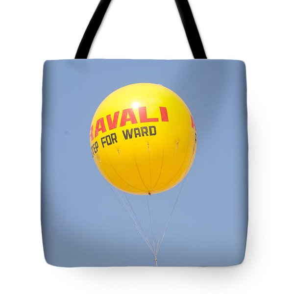 Tote Bag featuring the photograph A Hot Air Balloon In The Blue Sky by Ashish Agarwal