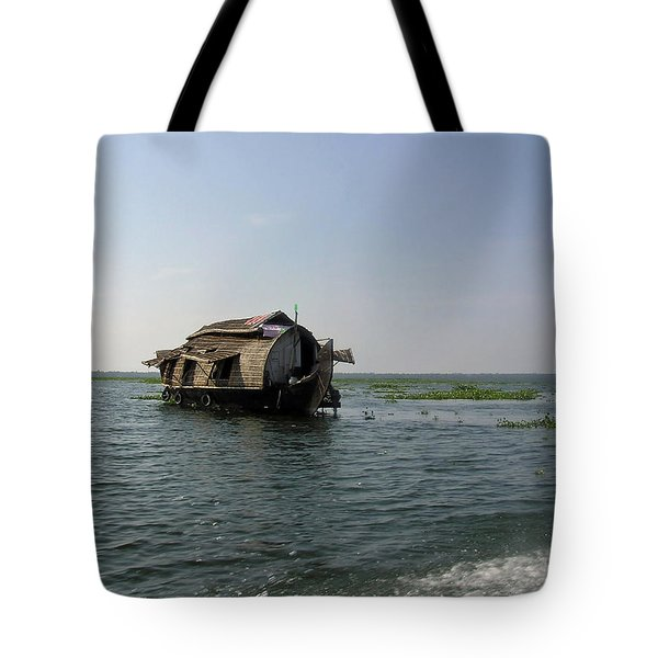 Tote Bag featuring the photograph A Houseboat Moving Placidly Through A Coastal Lagoon In Alleppey by Ashish Agarwal