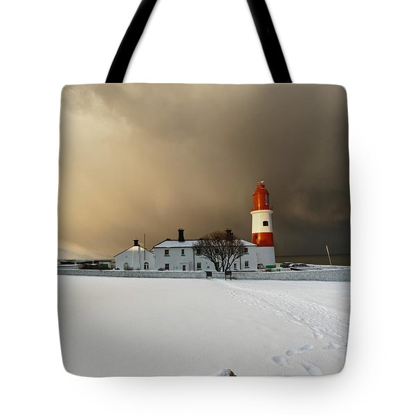 A Lighthouse And Building In Winter Tote Bag by John Short