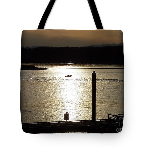 Tote Bag featuring the photograph A Lone Boat At Sunset by Chalet Roome-Rigdon
