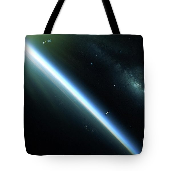 A Lone Satellite Drifts Silently Tote Bag by Kevin Lafin