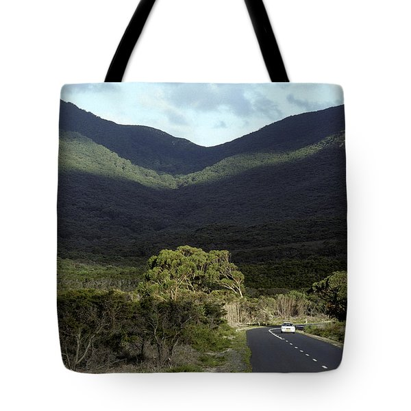 A Lone Vehicle Meanders Along A Tote Bag