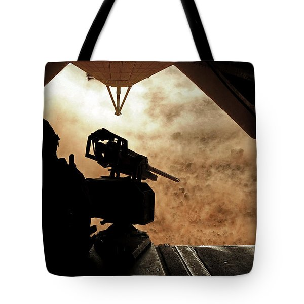 A Marine Waits For Dust To Clear While Tote Bag by Stocktrek Images