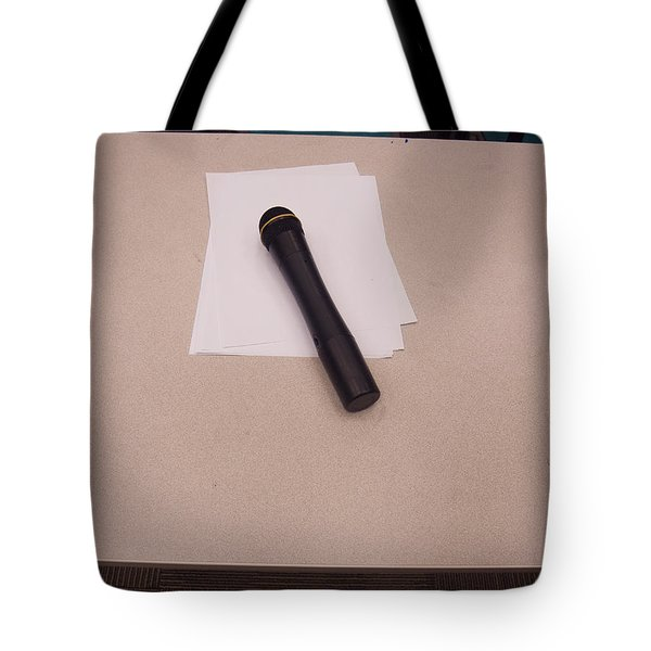 Tote Bag featuring the photograph A Microphone On The Lectern Of A Presentation Room by Ashish Agarwal