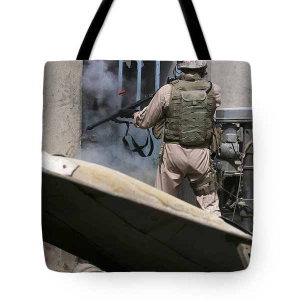 A Military Policeman Uses A Breaching Tote Bag by Stocktrek Images