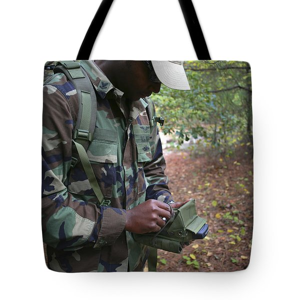 A Military Technician Uses A Pda Tote Bag by Michael Wood