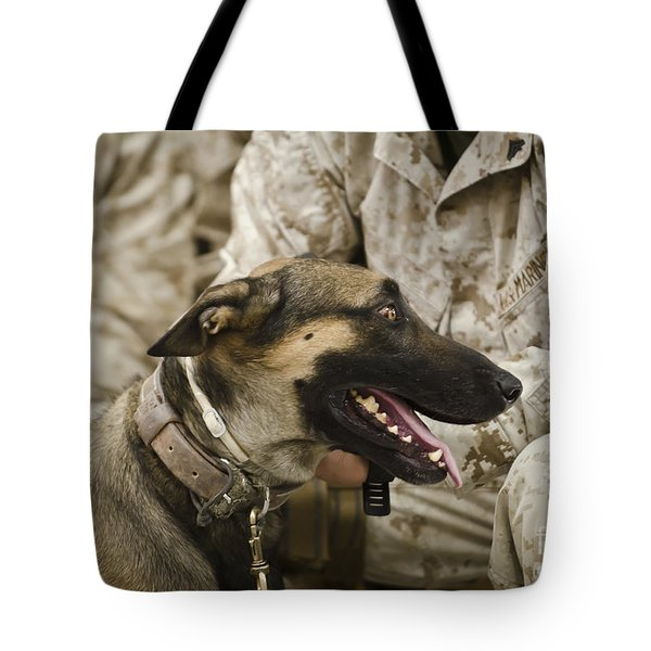 A Military Working Dog Sits At The Feet Tote Bag by Stocktrek Images
