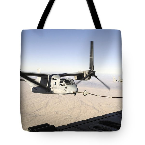 A Mv-22 Osprey Refuels Midflight While Tote Bag by Stocktrek Images