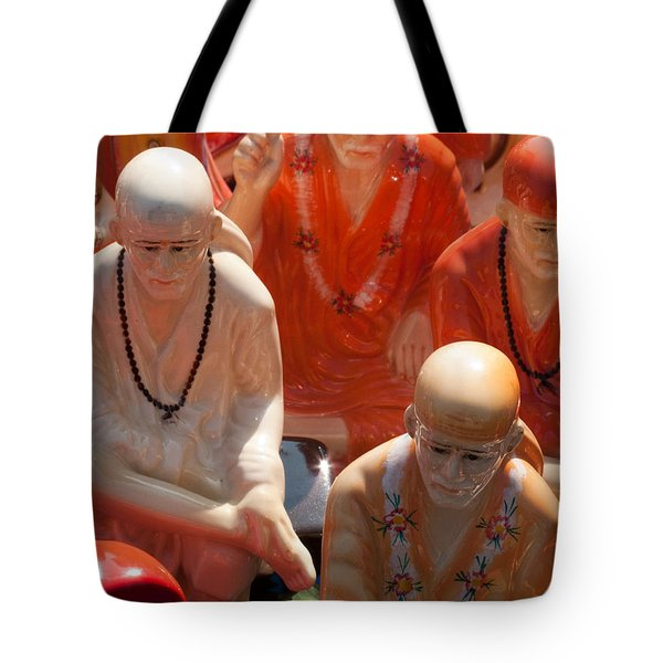 Tote Bag featuring the photograph A Number Of Statues Of The Shirdi Sai Baba For Sale At Surajkund Mela by Ashish Agarwal