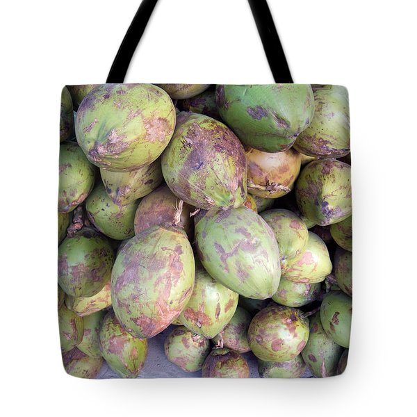 Tote Bag featuring the photograph A Number Of Tender Raw Coconuts In A Pile by Ashish Agarwal