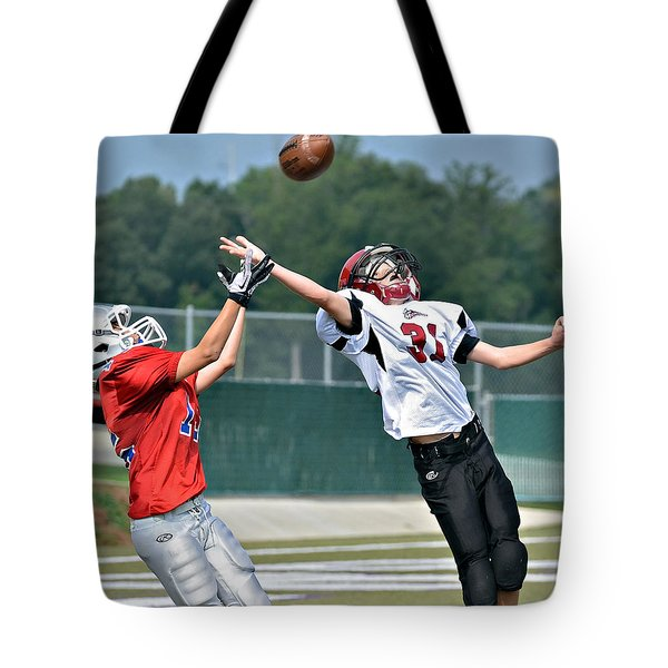 Tote Bag featuring the photograph A Pass For The Touchdown by Susan Leggett