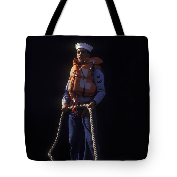 A Petty Officer Secures Rope Tied Tote Bag