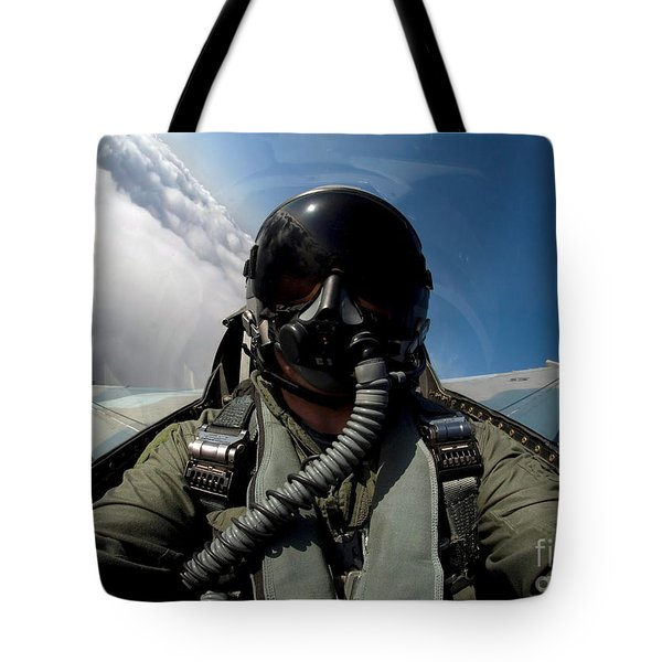A Pilot In The Cockpit Of An F-16 Tote Bag by Stocktrek Images